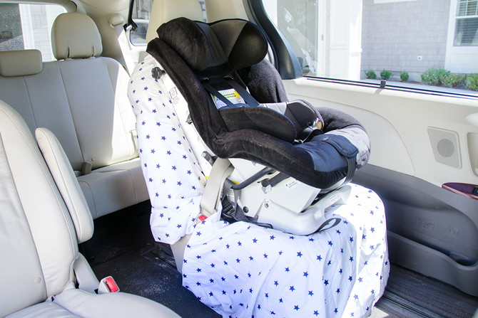 Protect car seats from snack-time spills with a fitted sheet.
