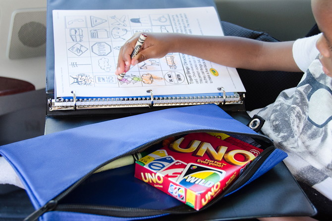 Fill a binder with printables, games, and other fun things for kids to do on the road or plane.