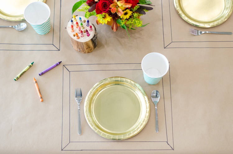 Cover the kids table with kraft paper and set out crayons to keep them entertained.