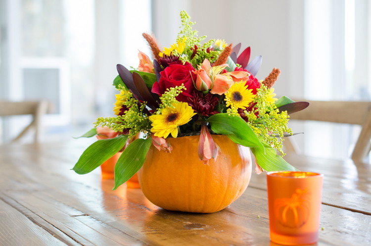 Use a hollowed-out pumpkin as a flower vase.