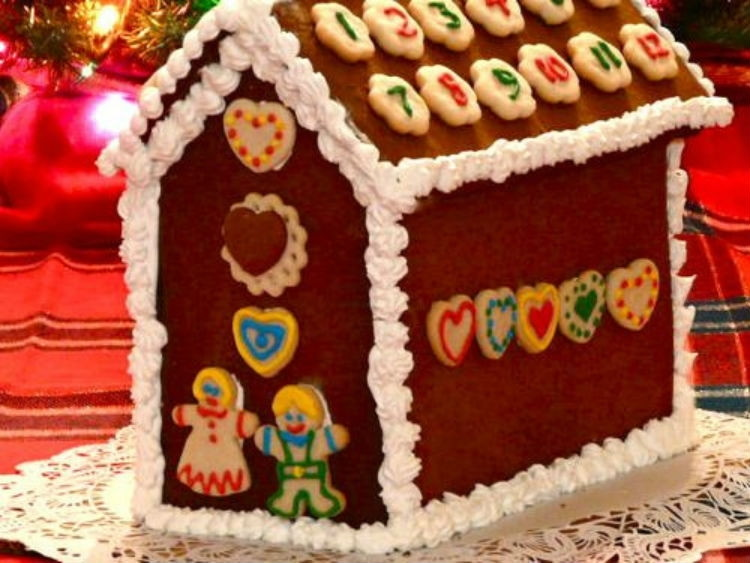 Decorate a gingerbread house with numbered cookies.