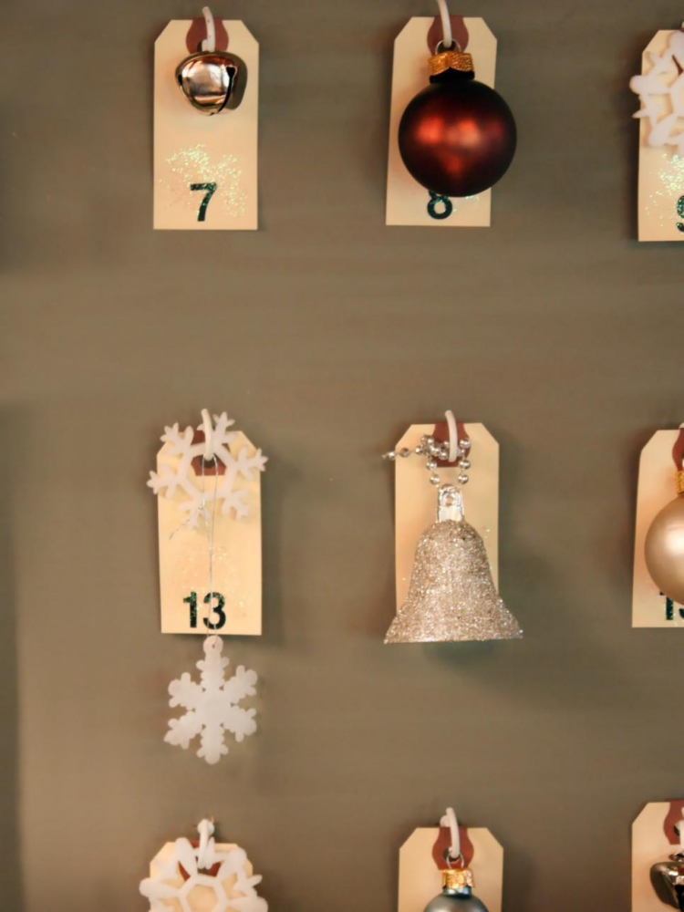 Attach ornaments to shipping tags.