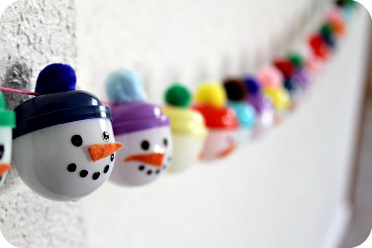 Fill plastic capsules decorated as snowmen.
