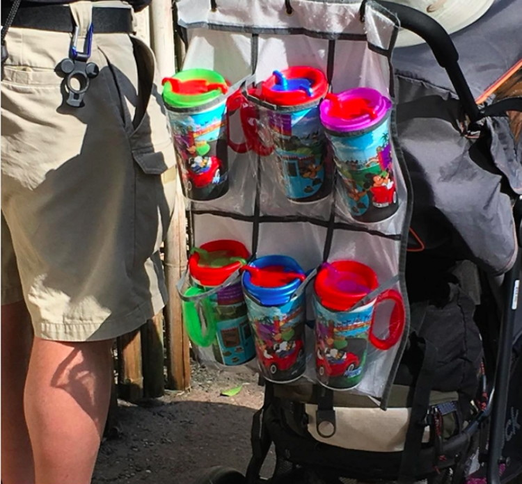 Attach an over-the-door organizer to a stroller to hold drinks.