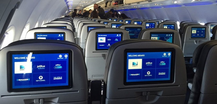 Book a seat in the rear of the plane to ensure overhead space for your carry-on.