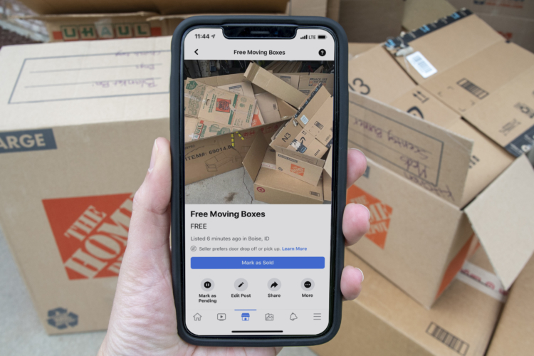 Facebook market place listing for free boxes with boxes in the background.