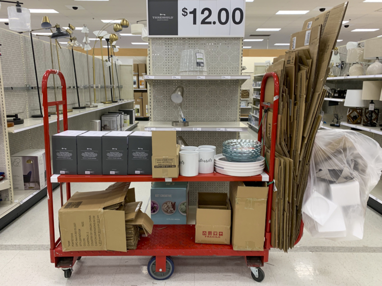 Cardboard boxes on a cart inside Target.