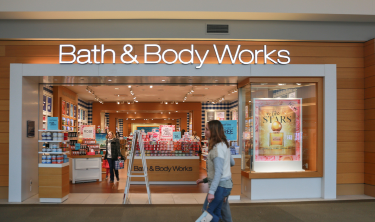 bath and body works entrance in mall with passersby