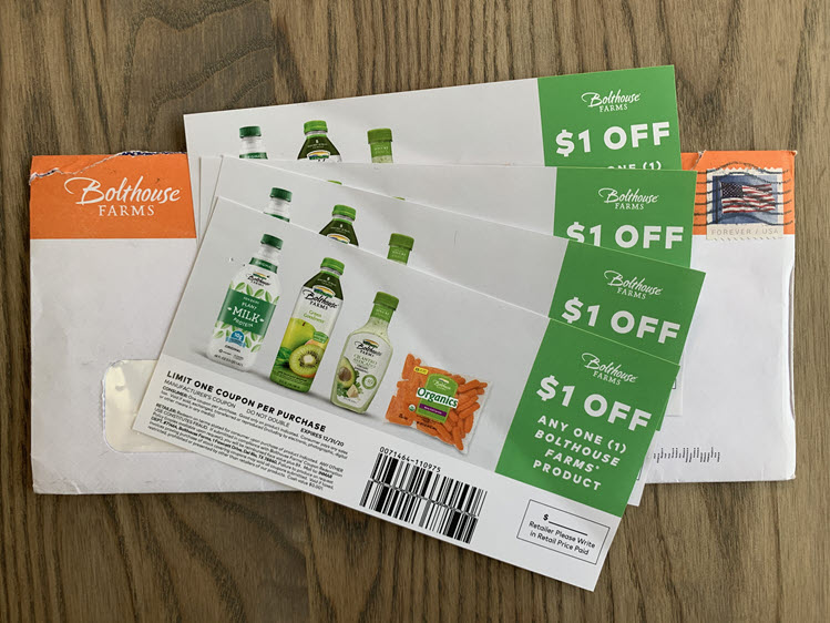 Four Bolthouse juice coupons on top of an envelope.