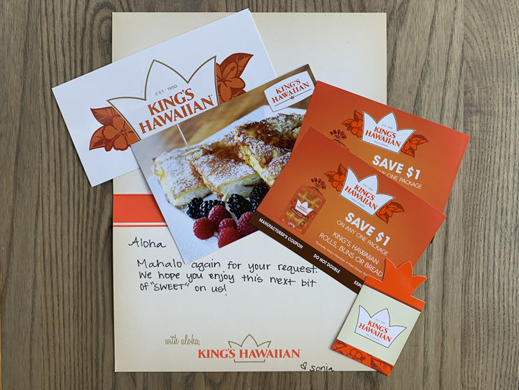Two coupons for King Hawaiian bread products, a sticker, and bookmark.