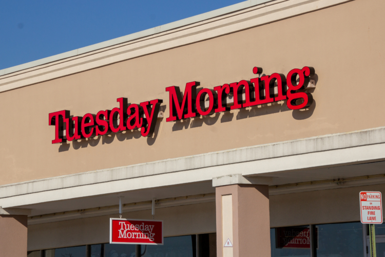 Tuesday Morning store sign on the front of a brick and mortar store location